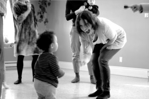 Lenni with 15-mos-old student C., doing the shaker dance