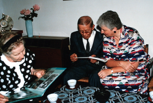 Dorothy Jones showing Dr. and Mrs. Suzuki pictures of Suzuki ECE classes -photo taken during the 1989 Suzuki Method World Convention in Matsumoto Japan.